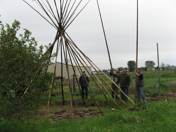 CTUR Teepee Building to Smoke Salmon