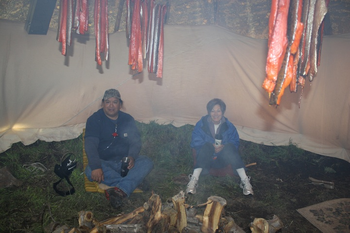 Stuart Harris and Anna Harding in a tipi smoking salmon