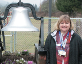 Laurie Briggs at the London School's original bell